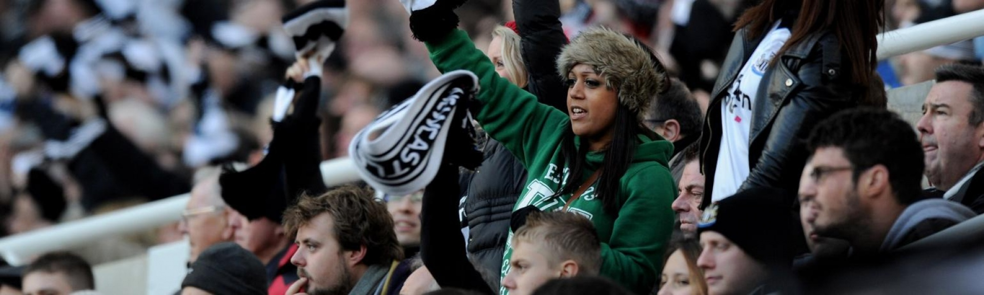 Football supporters at a Newcastle United F.C. match,